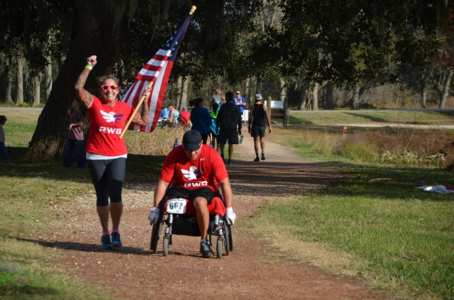 A veteran of one of the recent wars finishing the half marathon by wheelchair