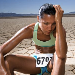 OK, this isn't me, but you don't want to finish your first race feeling like her. Photo: technicallyrunning.com