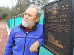 Gordy at the finish line plaque at Placer High School in Auburn. Photo c/o Auburn Journal